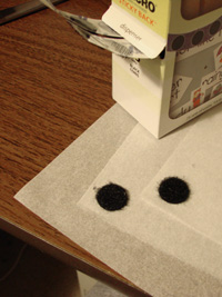 Velcro dots at corners of tracing paper