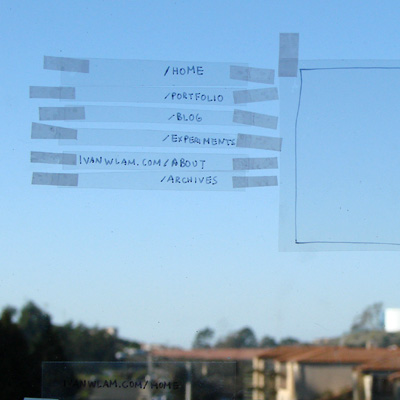 The layout of the site on transparency taped on the window with the sky in the background.